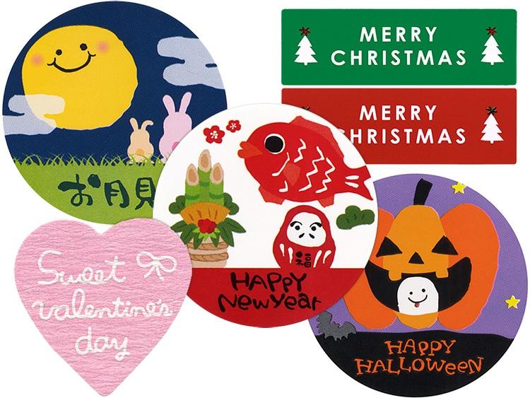 左上: 00-15517-469 シール お月見、左下:00-15517-358 バレンタインシール バレンタインハート1、真ん中:00-15517-288 シール HAPPY New Year、右上:00-15517-509 クリスマスシール MERRY CHRISTMAS、右下:00-15517-753 ハロウィンシール 星空とカボチャ。
