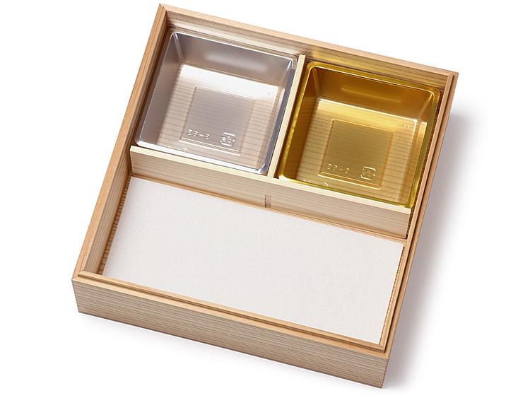 木製おせち重箱 信楽印籠 6.5寸を使用。吸水マット6.5寸1/2 と P製のぞき 松花堂 6.5寸用を組み合わせて使用した画像