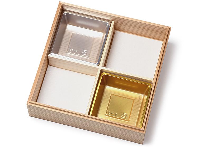 木製おせち重箱 信楽印籠 6.5寸に吸水マット6.5寸1/4 と P製のぞき 松花堂 6.5寸用を組み合わせて使用した画像